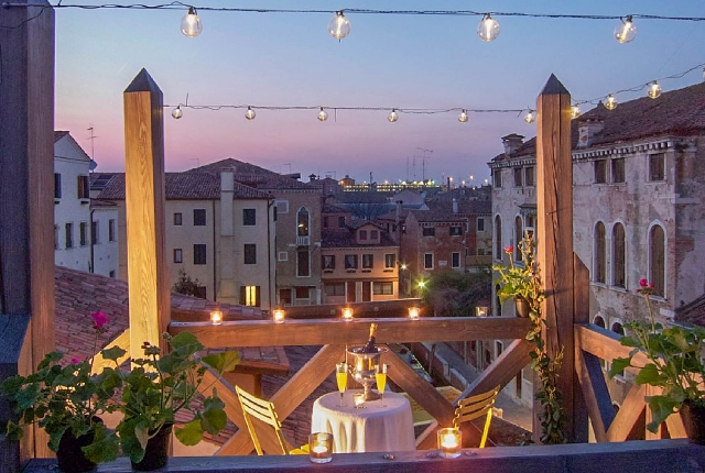 Enjoy A Cozy Dinner On A Rooftop Along The Canal Side
