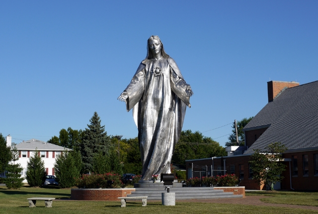 Seek Peace Near The Giant Statue Of Mother Mary
